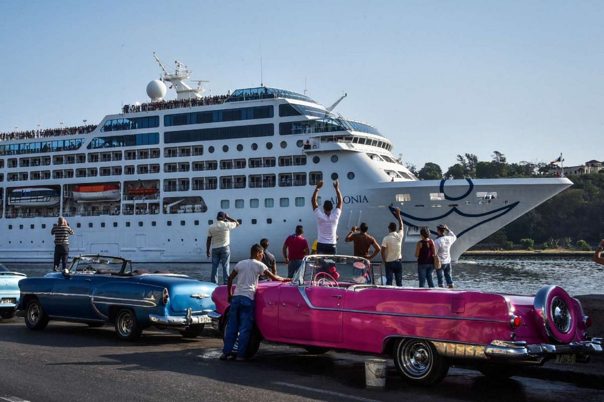 Cubans watch as the first US-to-Cuba cruise ship to arrive in the island nation in decades glides into the port of Havana, on May 2, 2016. PHOTO: AFP