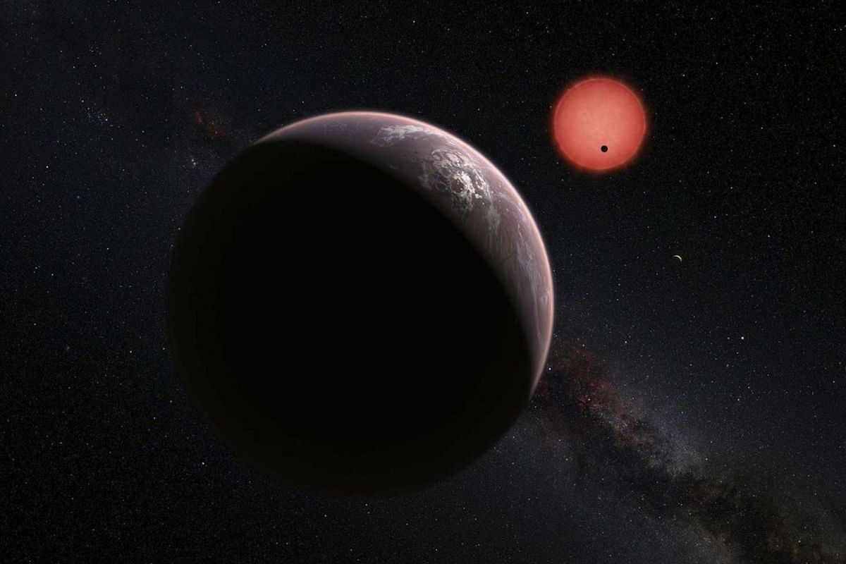 An artist's impression shows an imagined view of the three planets orbiting an ultracool dwarf star just 40 light-years from Earth that were discovered using a specialist telescope at ESO's La Silla Observatory in Chile, according to new findings by