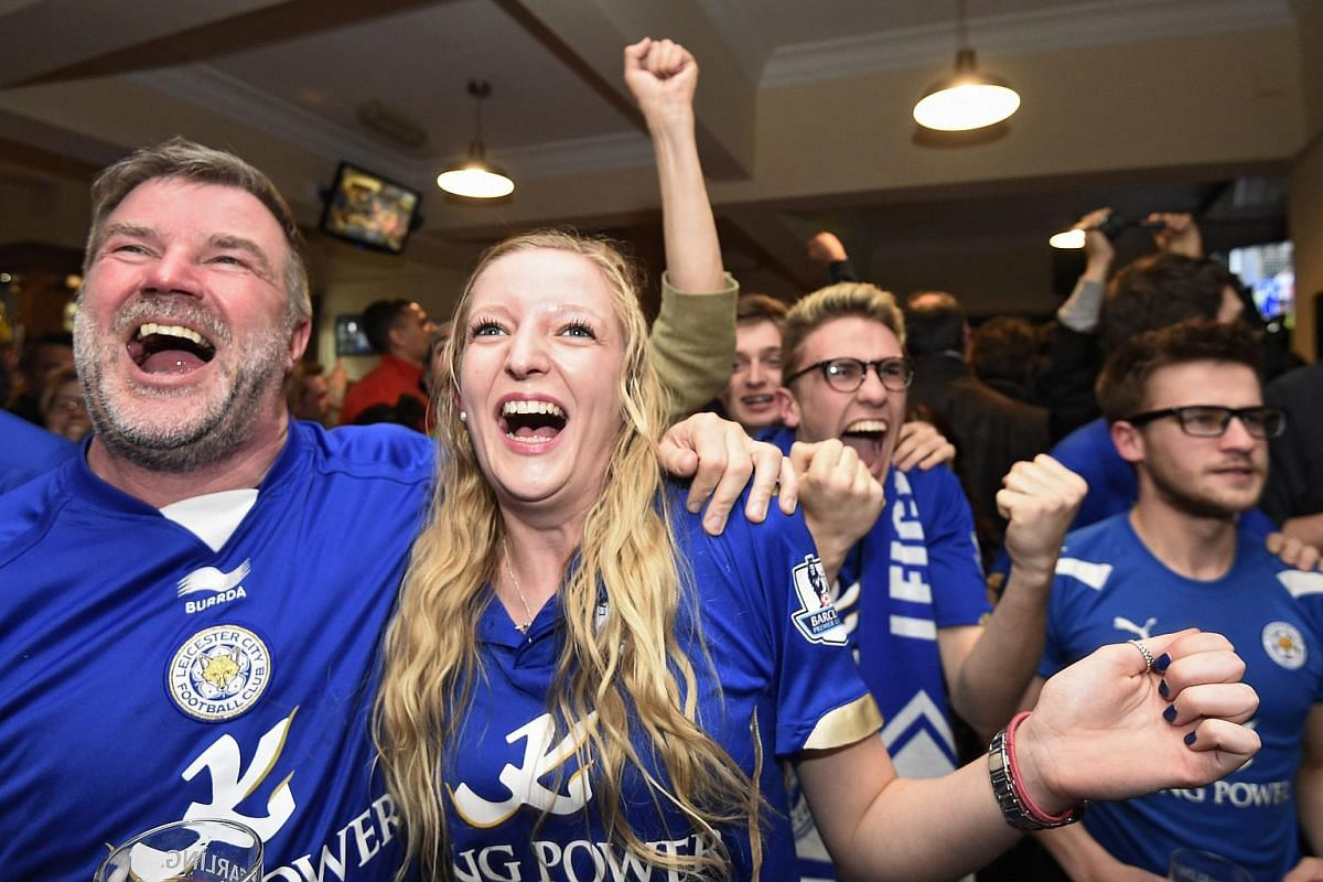 Leicester City fans celebrate winning the Premier league after Tottenham Hotspur could only manage a 2-2 draw with Chelsea.