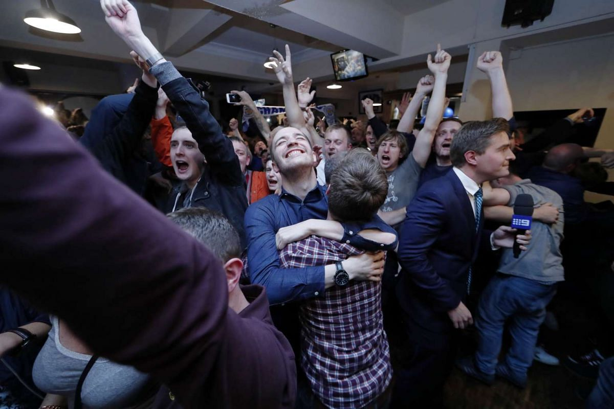 Leicester City fans celebrate winning the Premier League in a pub in Leicester.