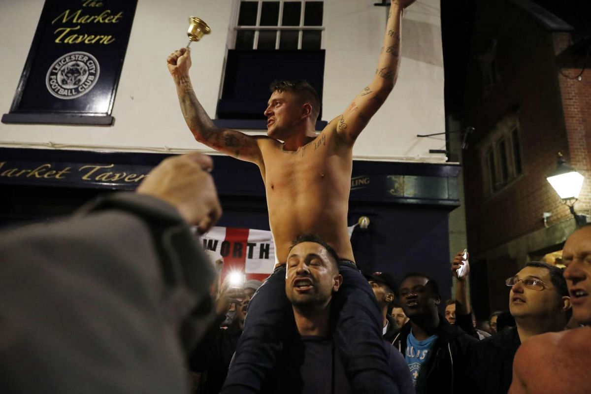 Leicester City fans celebrate winning the Premier League in central Leicester.