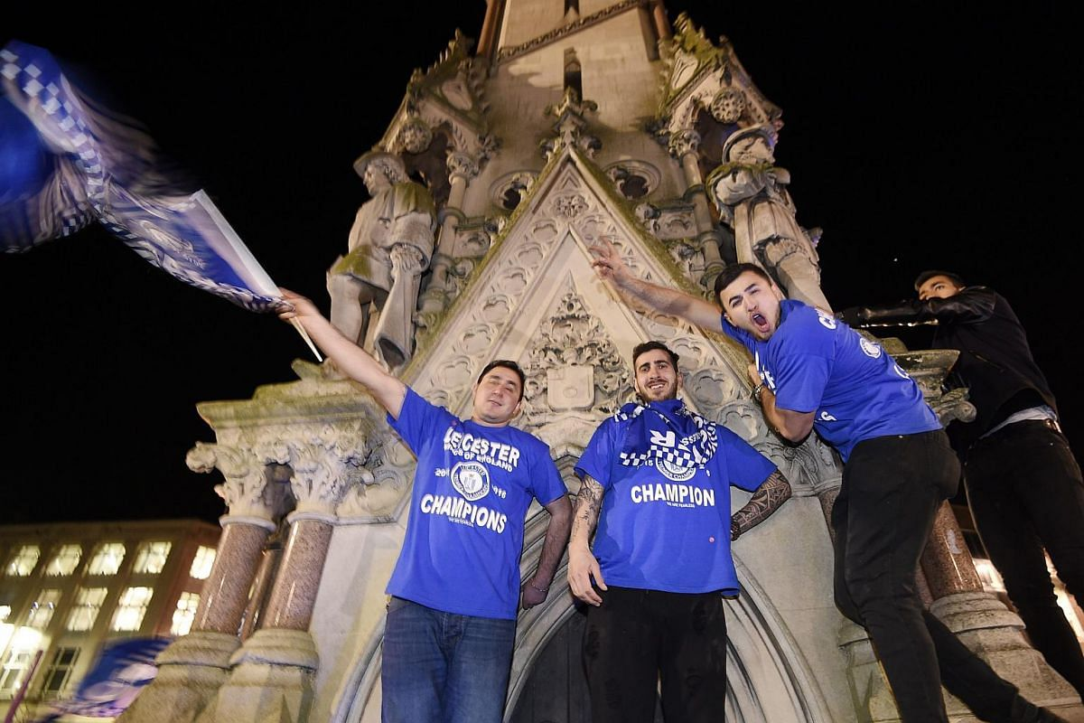 Leicester City supporters celebrate at Haymarket Memorial Clock Tower after the match between Chelsea and Tottenham Hotspur, in Leicester, Britain, on May 2, 2016.