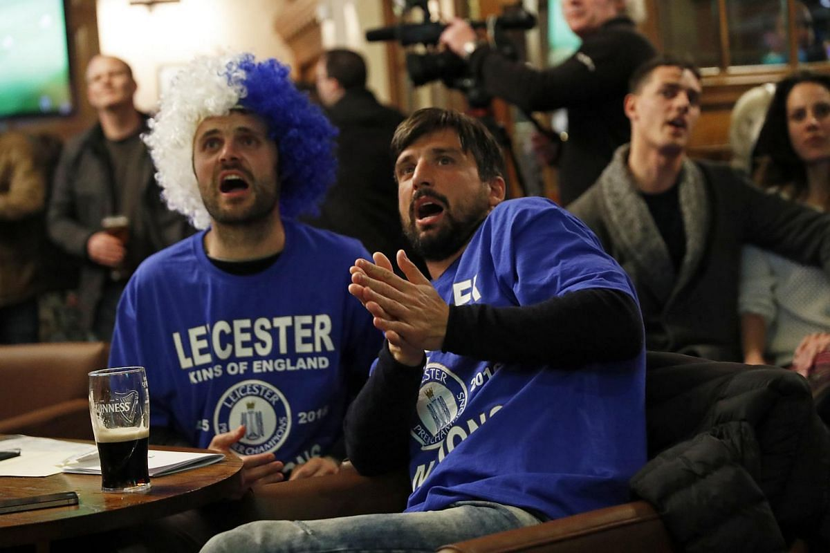 Leicester City fans watch the Chelsea v Tottenham Hotspur game in pub in Leicester, Britain, on May 2, 2016.