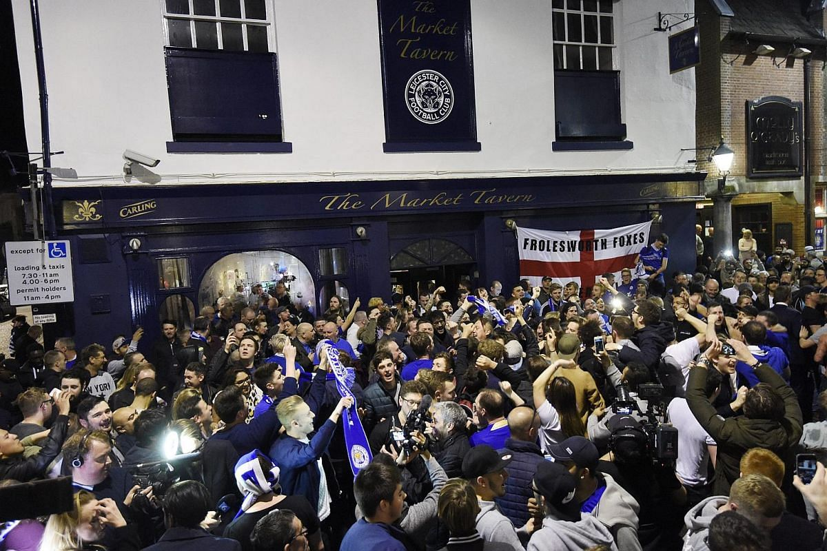 Leicester City supporters celebrate after the match between Chelsea and Tottenham Hotspur, in Leicester, Britain, on May 2, 2016.