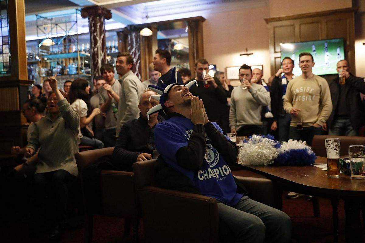 Leicester City fans celebrating after Chelsea's first goal.