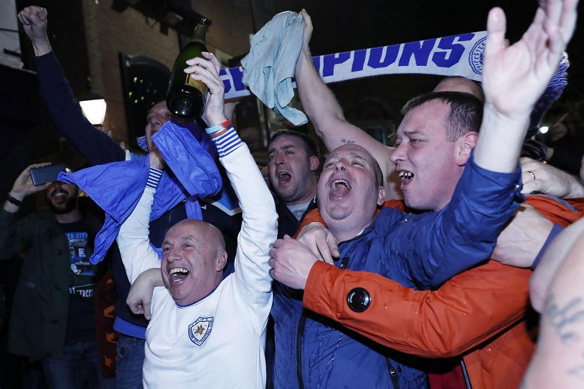 Leicester City fans celebrate winning the Premier League on May 2, 2016.