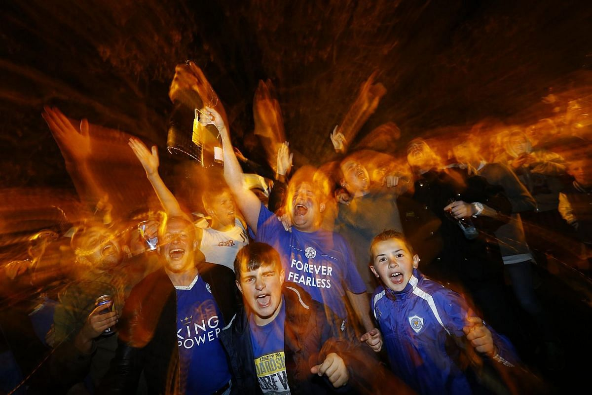 Leicester City fans watch the Chelsea v Tottenham Hotspur game at Jamie Vardy's house in Leicester, Britain, on May 2, 2016.