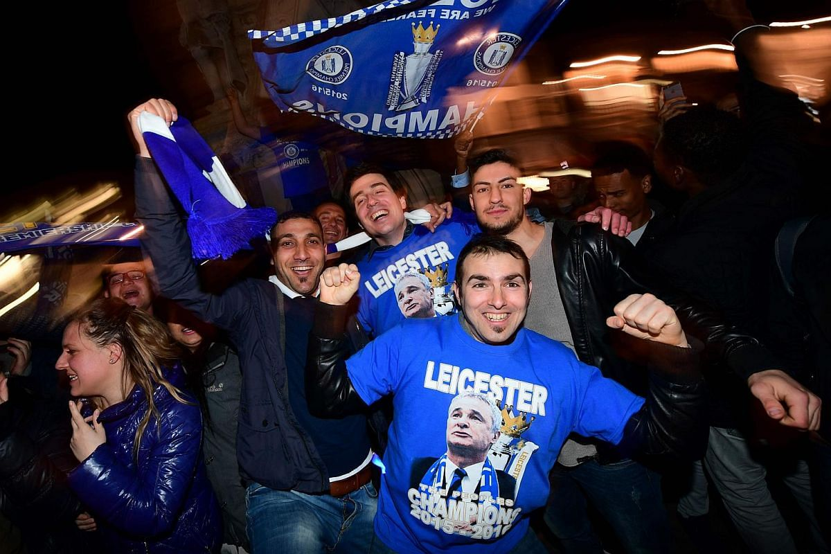 Leicester City fans celebrate their team becoming the English Premier League champions in Leicester, Britain, on May 2, 2016.