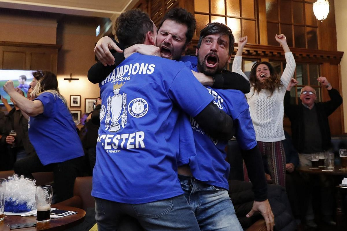 Leicester City fans celebrating Chelsea's second goal.