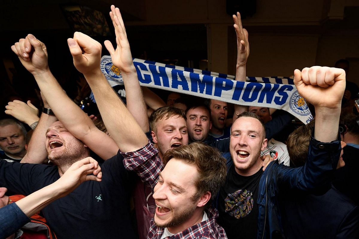 Leicester City fans celebrate their team becoming the English Premier League champions on May 2, 2016.