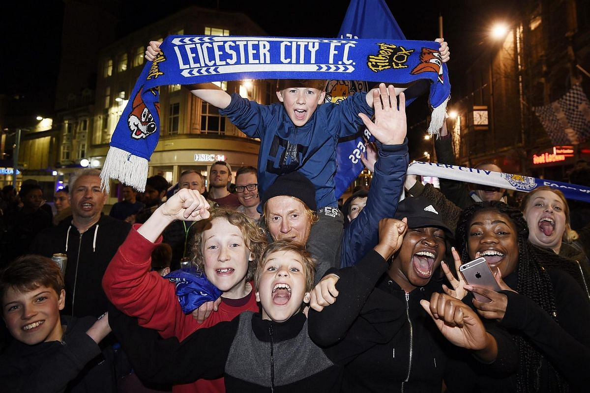 Leicester City supporters celebrate near the Haymarket Memorial Clock Tower in Leicester, Britain, on May 2, 2016.