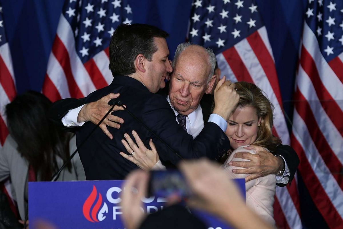 Republican presidential candidate, Sen. Ted Cruz (left) hugs his father, Rafael Cruz and wife Heidi Cruz after announcing the suspension of his campaign during an election night watch party at the Crowne Plaza Downtown Union Station on May 3, 2016 in