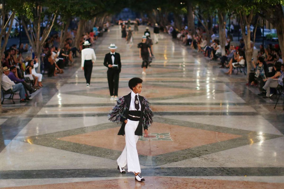Models present creations by Chanel in Cuba on May 3, 2016.