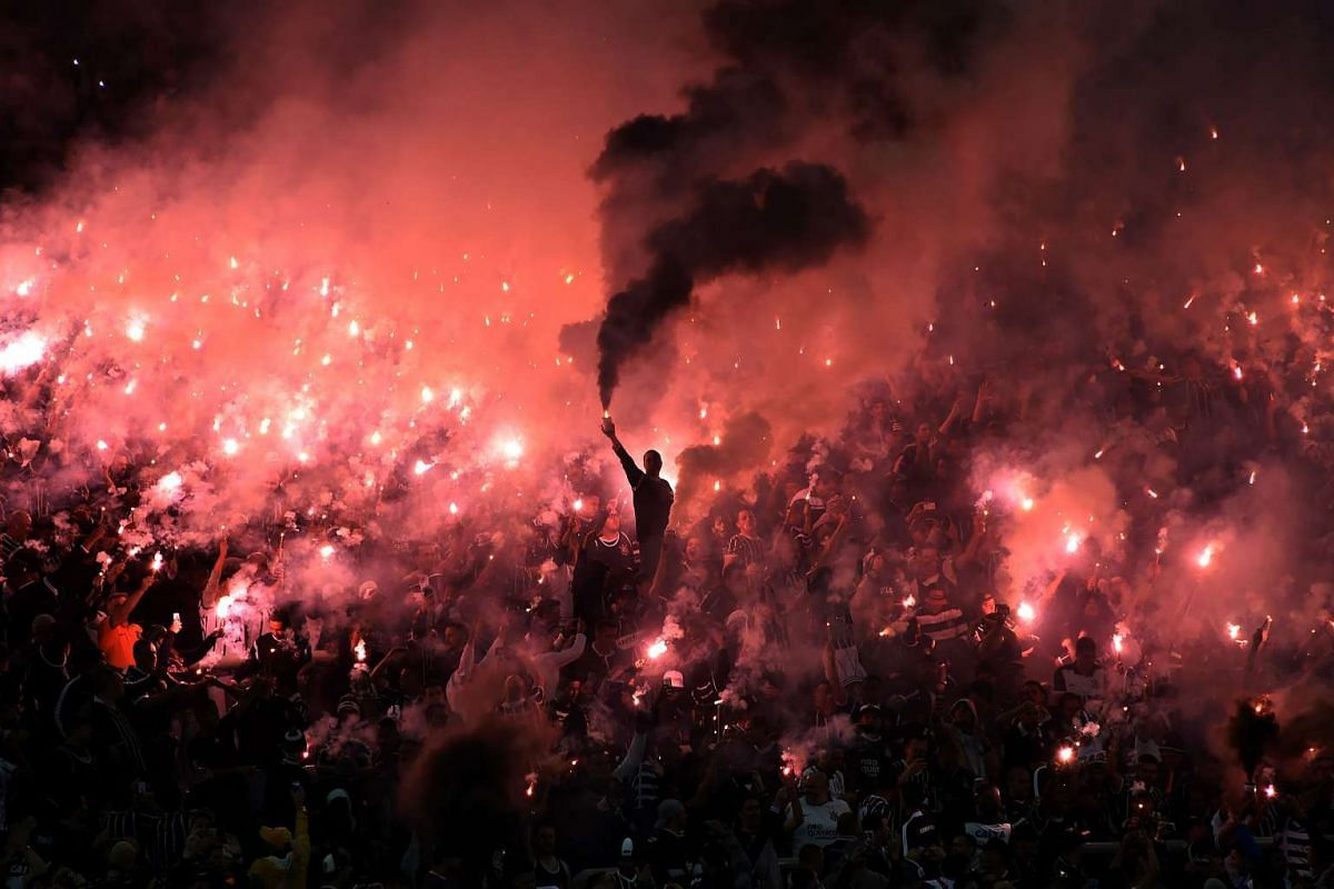 Supporters of Brazilian Corinthians cheer for their team during the 2016 Copa Libertadores football match against Uruguay's Nacional held at Arena Corinthians stadium, in Sao Paulo, Brazil, on May 4, 2016. PHOTO: AFP