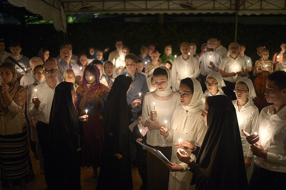 Scripture verses are read out by a deacon in Church Slavonic - an old church language - during the midnight service to celebrate Easter.