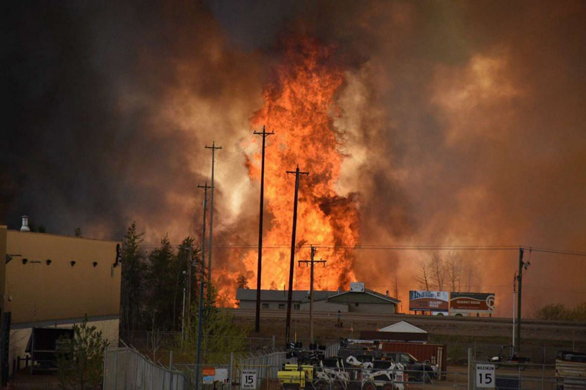 Flames rise at an Industrial area south of Fort McMurray, Alberta Canada.