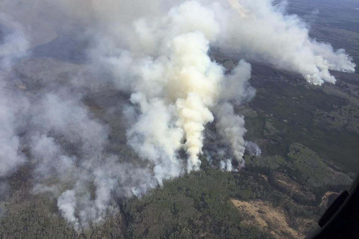 An aerial view from the helicopter of Alberta Premier Rachel Notley shows smoke rising from raging wildfires.