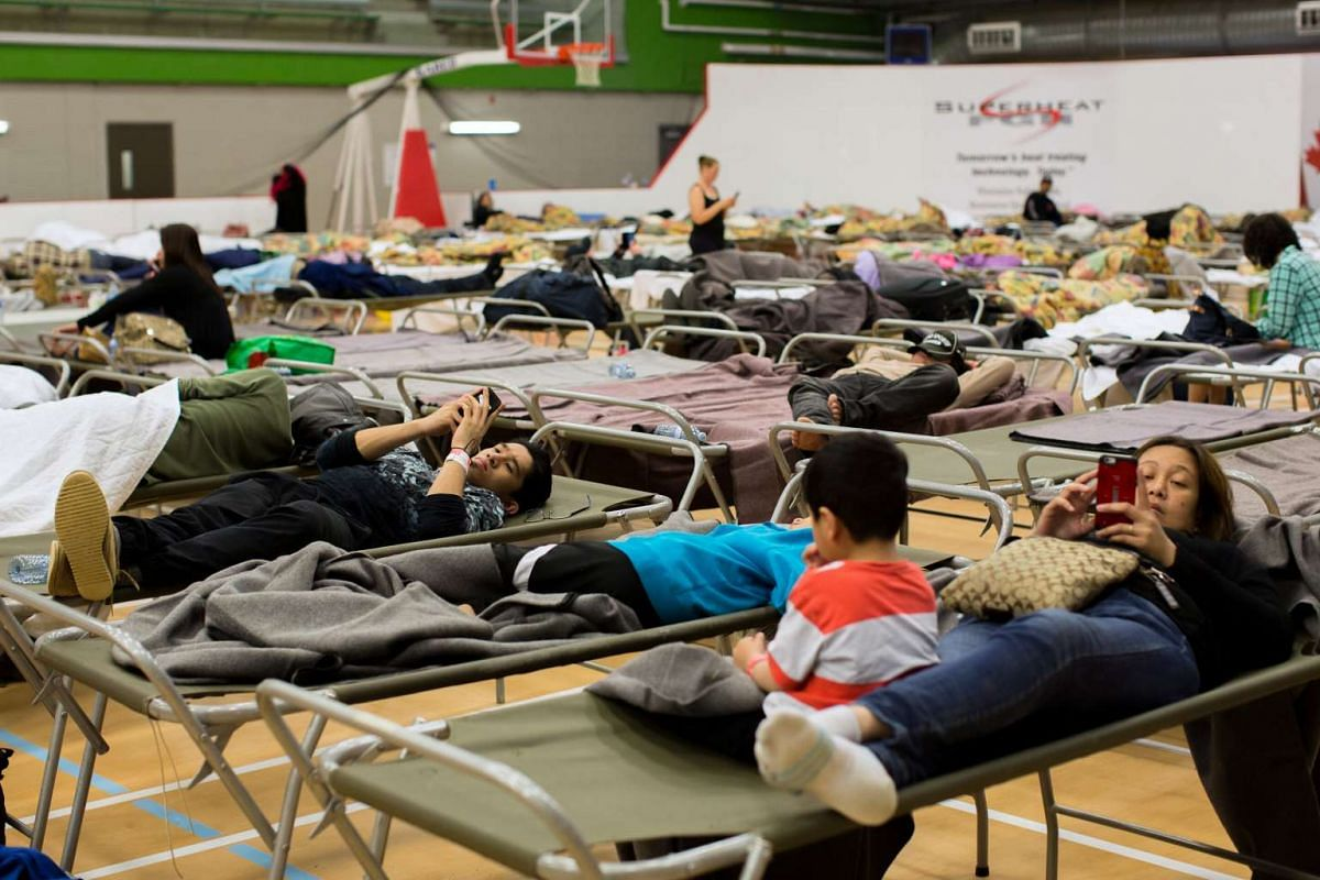 Fort McMurray residents rest at a community centre in Anzac, Alberta after being evacuated.