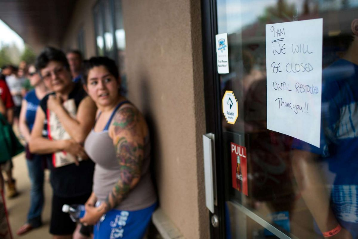 Residents of Fort McMurray line-up outside a grocery store after they were ordered to evacuate due to the raging wildfire, in Anzac, Alberta, Canada.