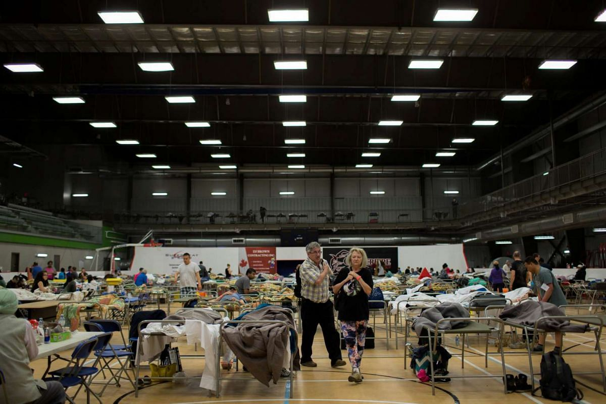 Fort McMurray residents are seen at a community centre in Anzac, Alberta after being evacuated.