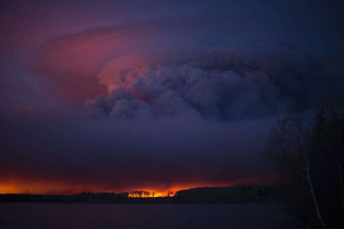 A handout photo provided by the Government of Alberta on 05 May 2016 shows a massive wildfire raging near Anzac, a hamlet 48 km southwest of Fort McMurray, Alberta, Canada, May 4,  2016. EPA/GOVERNMENT OF ALBERTA HANDOUT