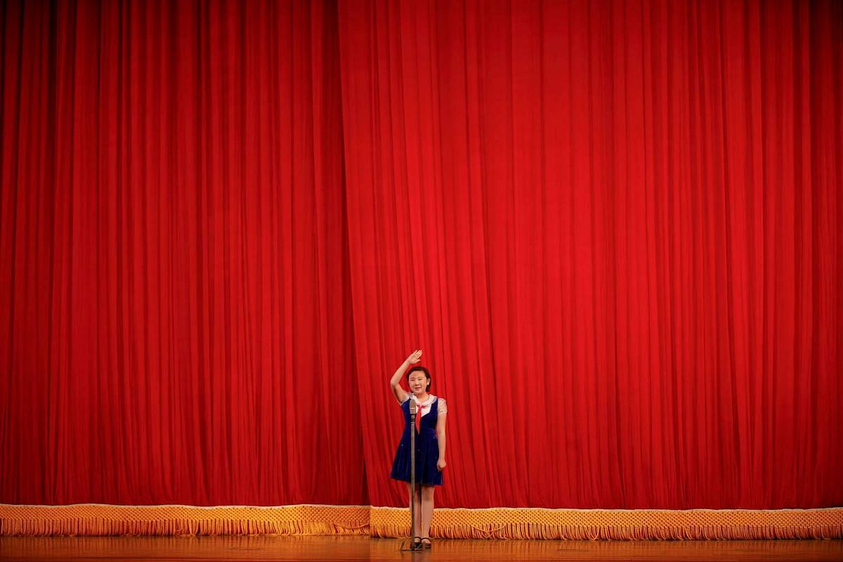 A girl salutes to visitors before a show at the Mangyongdae Children's Palace in central Pyongyang, North Korea May 5, 2016. PHOTO: REUTERS