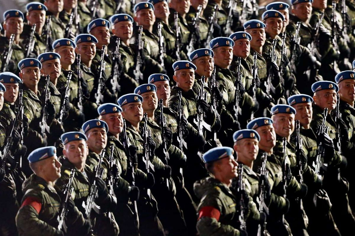 Russian servicemen march during a rehearsal for the Victory Day parade to mark the 71st anniversary of the victory over Nazi Germany in World War Two in Red Square in Moscow, Russia, May 5, 2016. PHOTO: REUTERS