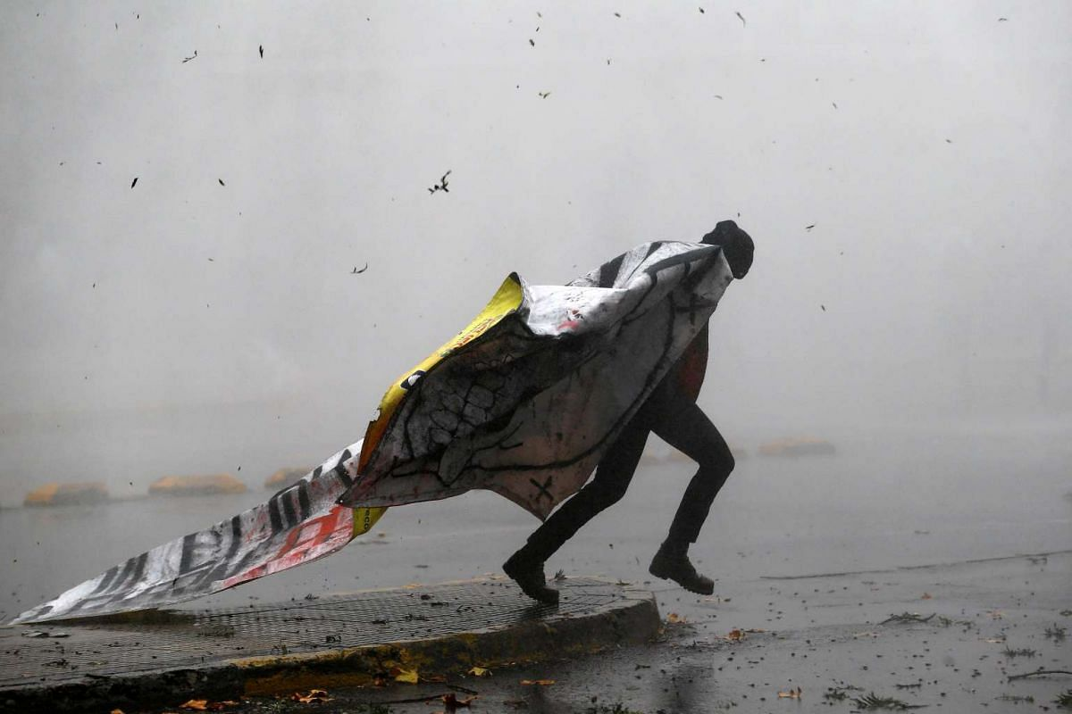 A student protester runs away as they clash with riot police during a demonstration to demand changes in the education system in Santiago, Chile, May 5, 2016. PHOTO: REUTERS