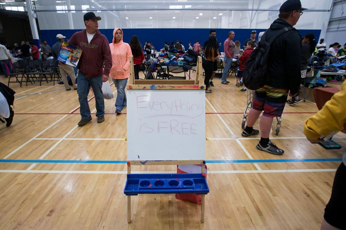 Wildfire evacuees look through donations at a community center in Alberta, Canada, on May 5, 2016.