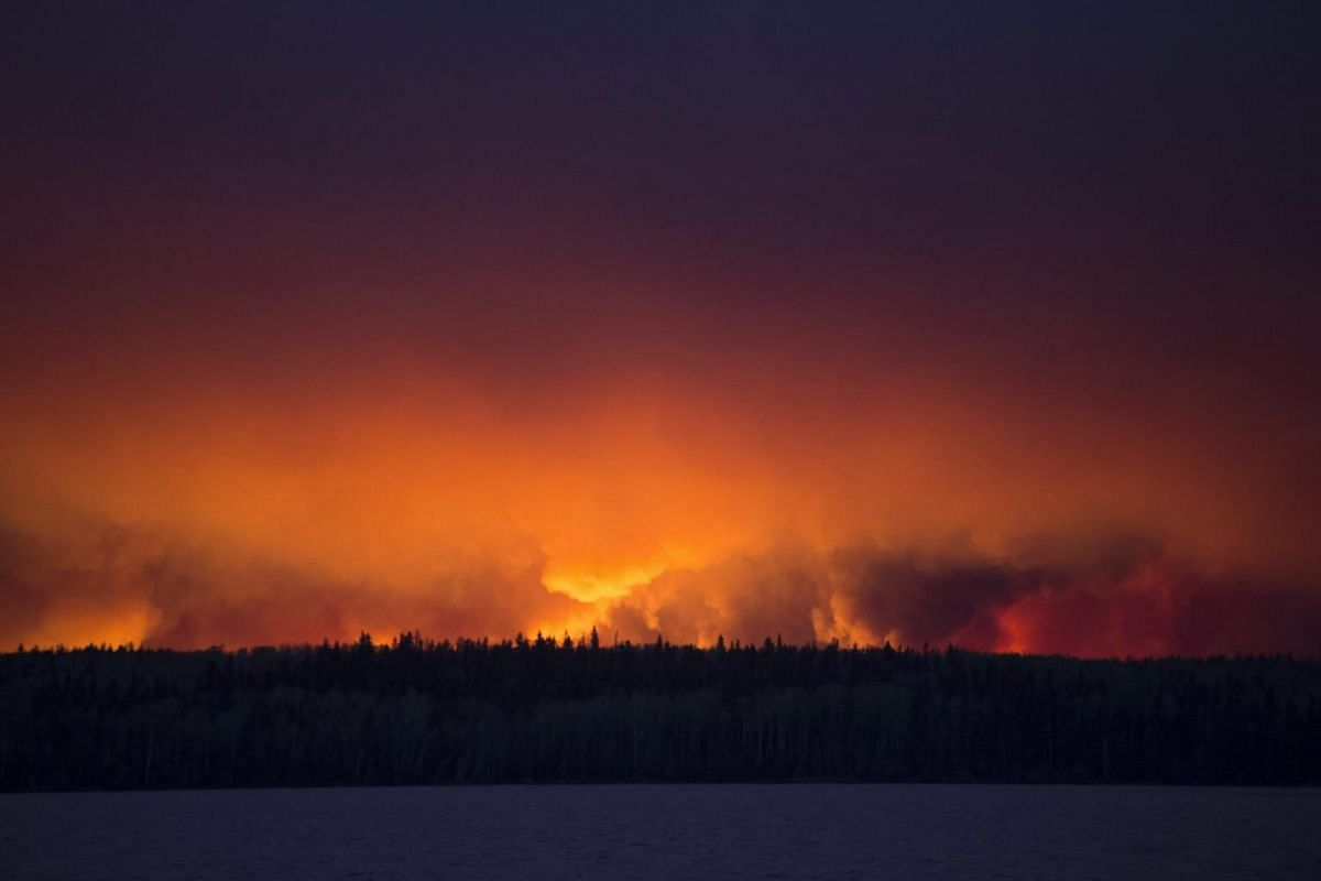 A massive wildfire raging near Anzac, a hamlet 48km southwest of Fort McMurray, Alberta, Canada, on May 4, 2016.