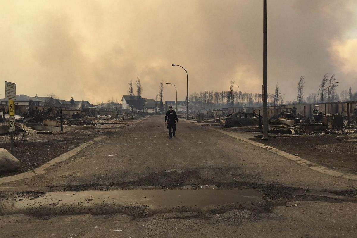 A Mountie surveys the damage on a street in Fort McMurray in this image posted on social media, on May 4, 2016.