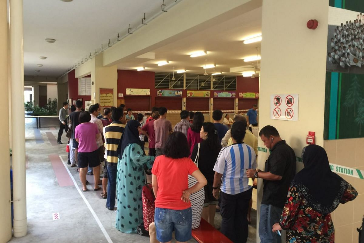 Residents awaiting their turn to vote at Bukit Batok Secondary School.
