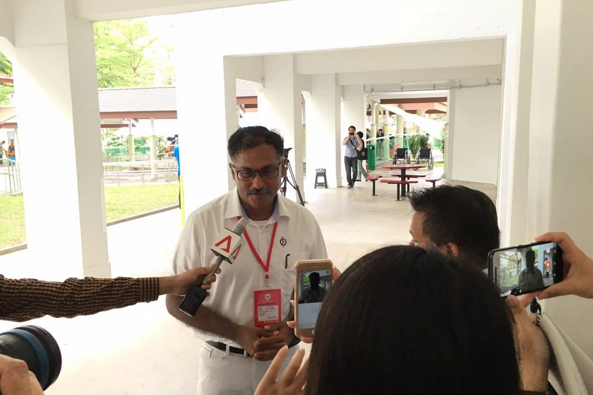 People's Action Party (PAP) candidate Murali Pillai speaking to media at around 9.30am outside the polling station at Block 105A, Bukit Batok Central.
