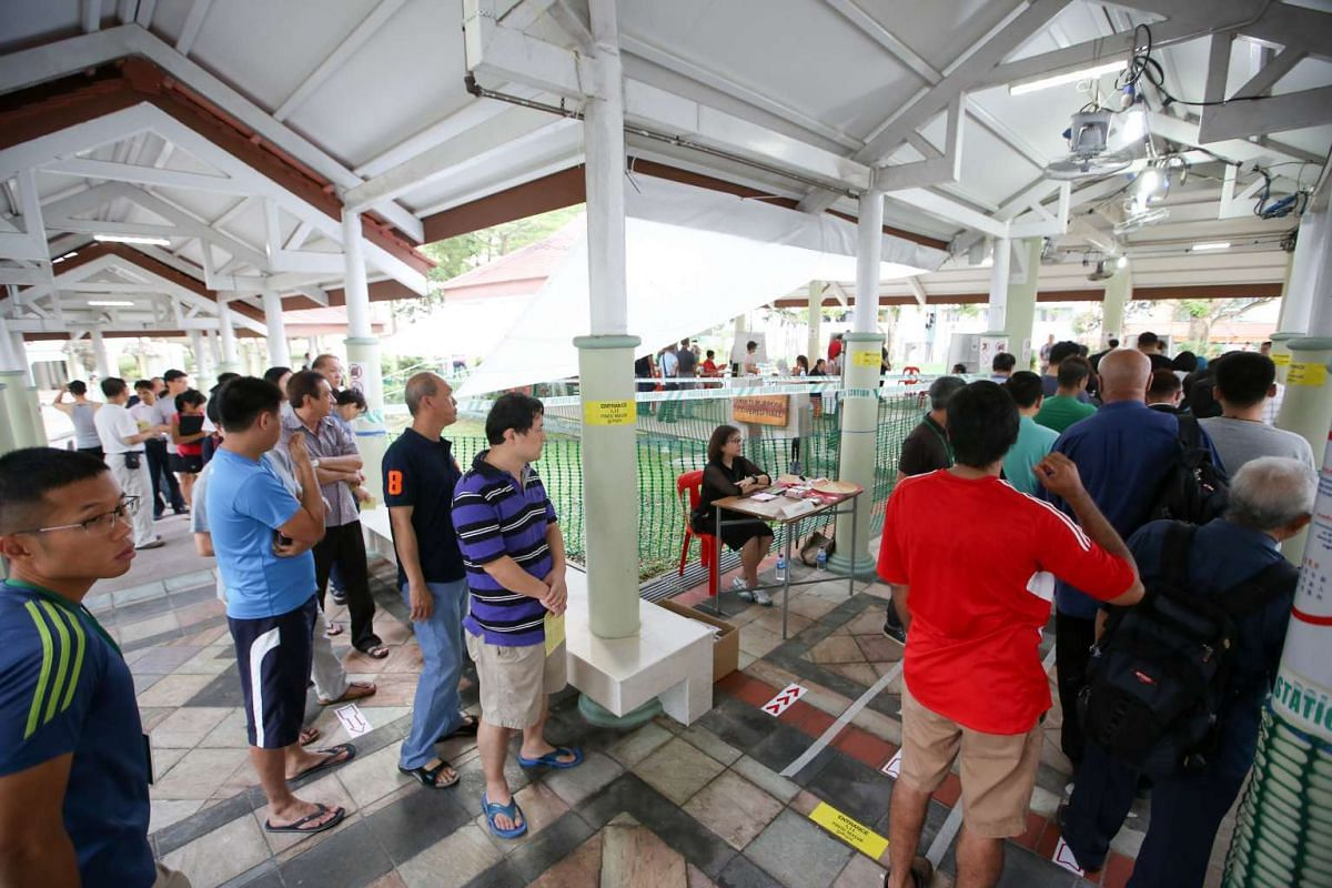 Voters queuing at the HDB Pavilion at Block 105A, Bukit Batok Central, at about 8am.
