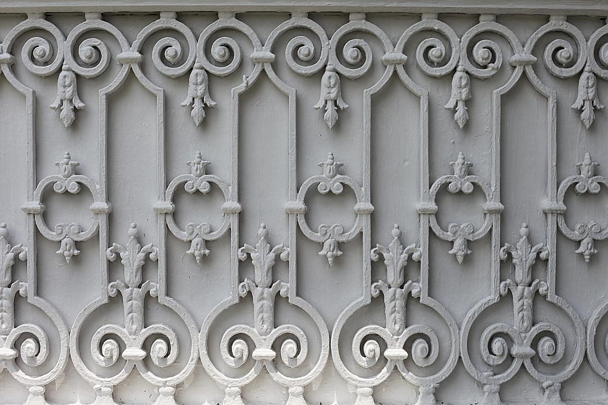 Cast-iron work (above) on the facade of the building; and encaustic tiles, where the colour of the tiles comes from the clay used.