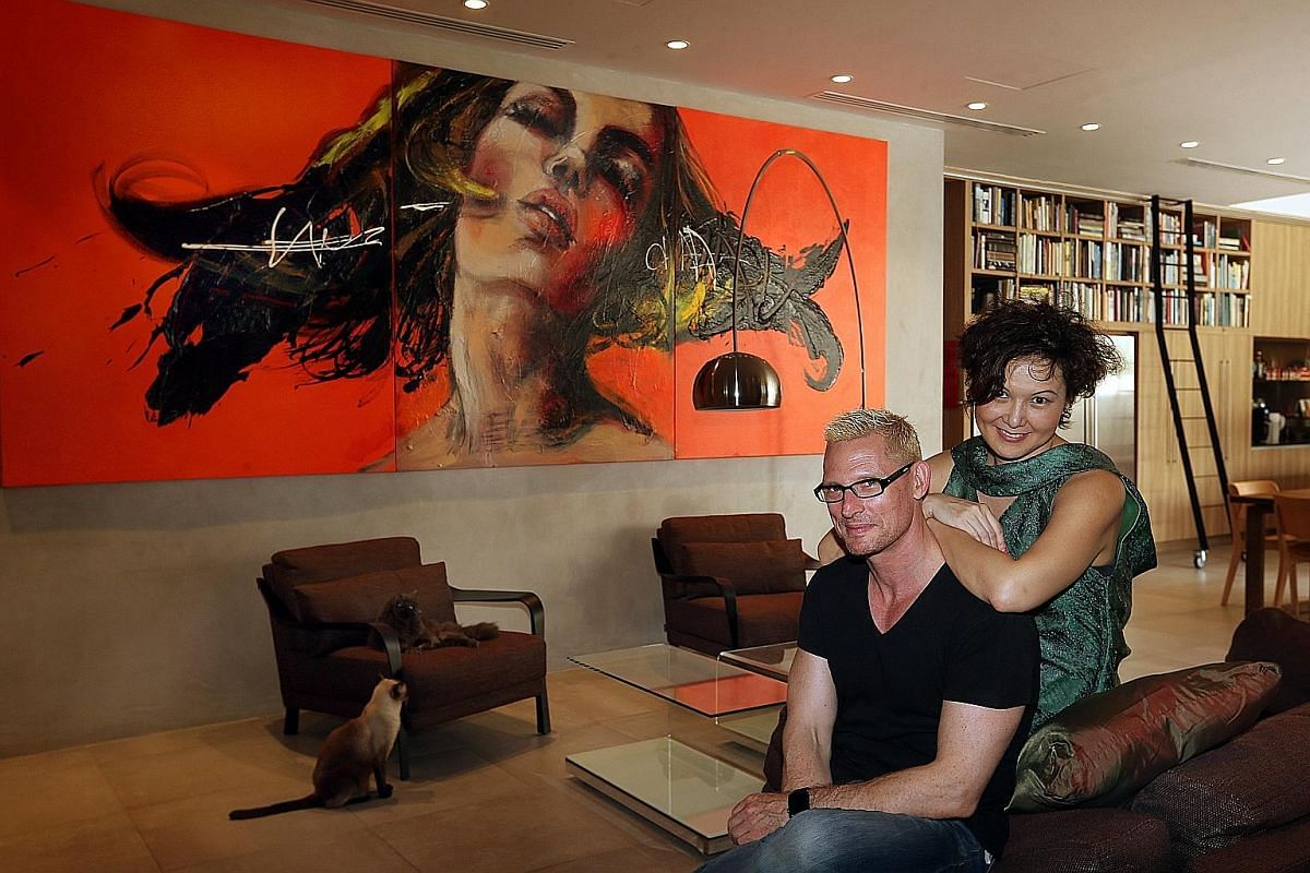 Canadian artist Joanne Corneau's artwork in the living room of chef Emmanuel Stroobant and Ms Edina Hong (both above).