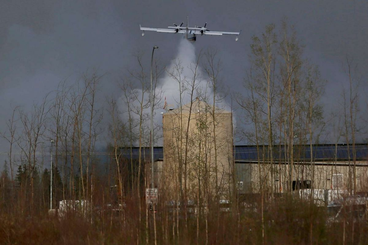 A plane dumping water on the wildfires near Fort McMurray on May 6.