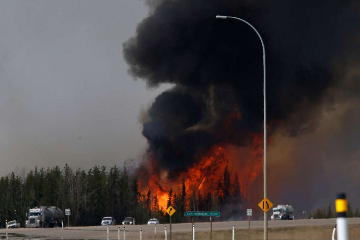 A wildfire burning near Highway 63, south of Fort McMurray, on May 6.
