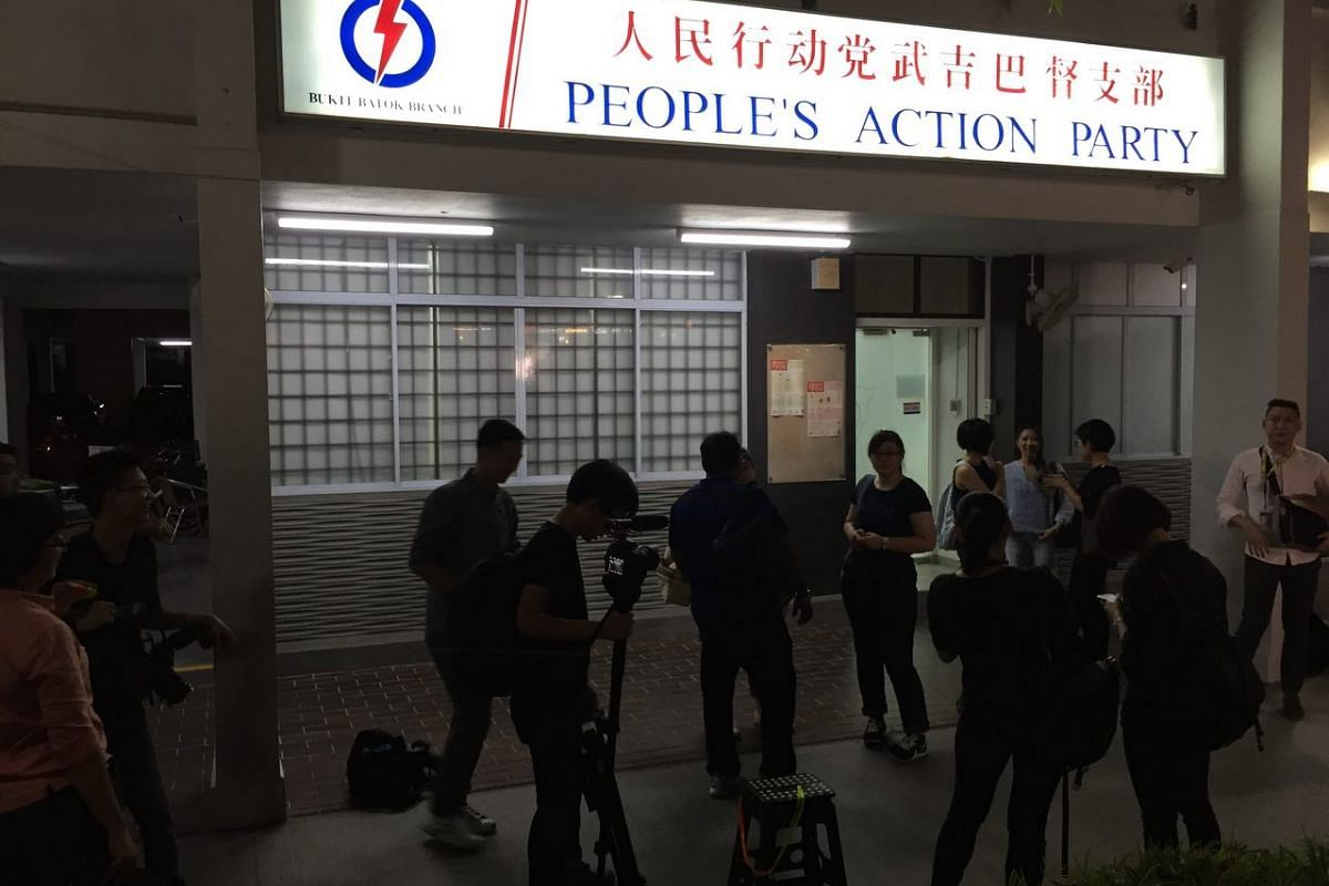 Members of the media congregating outside the People's Action Party's Bukit Batok branch on Saturday evening.