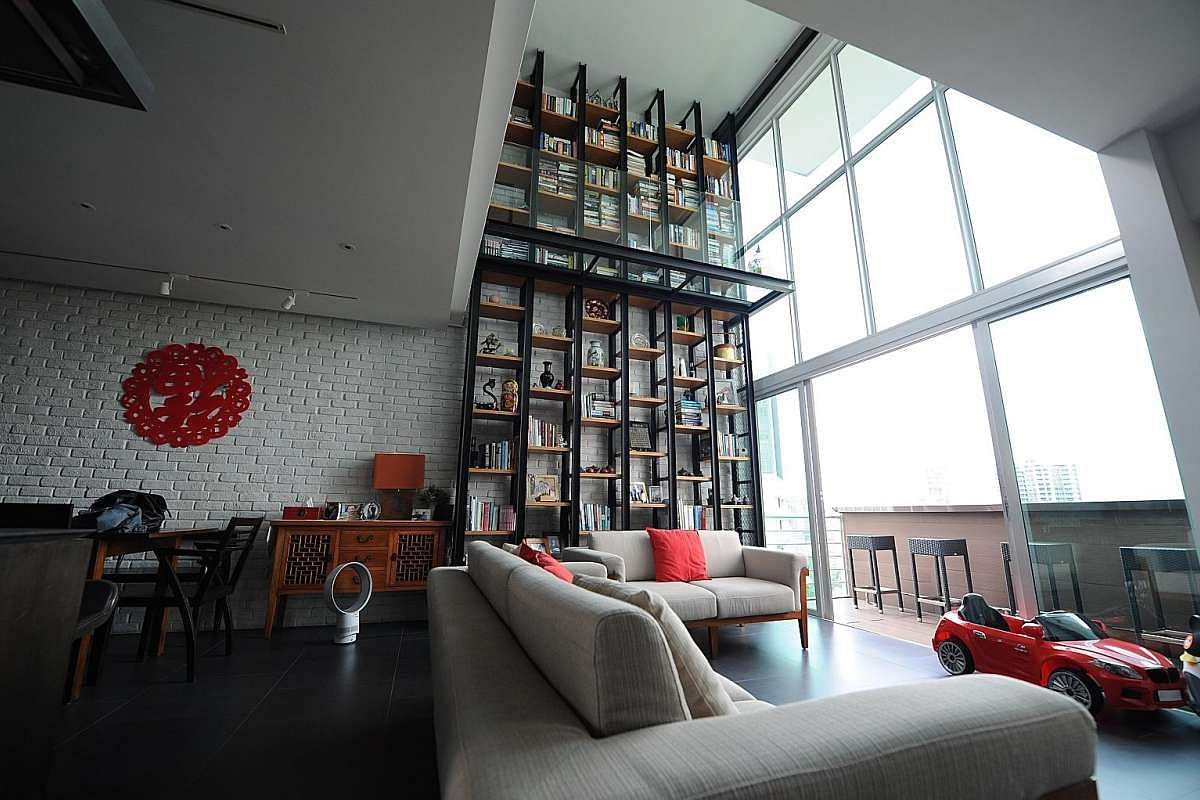 Mr Low Soon Teck and Ms Vivian Yeung have about 900 books in their penthouse in Balestier Road (above).