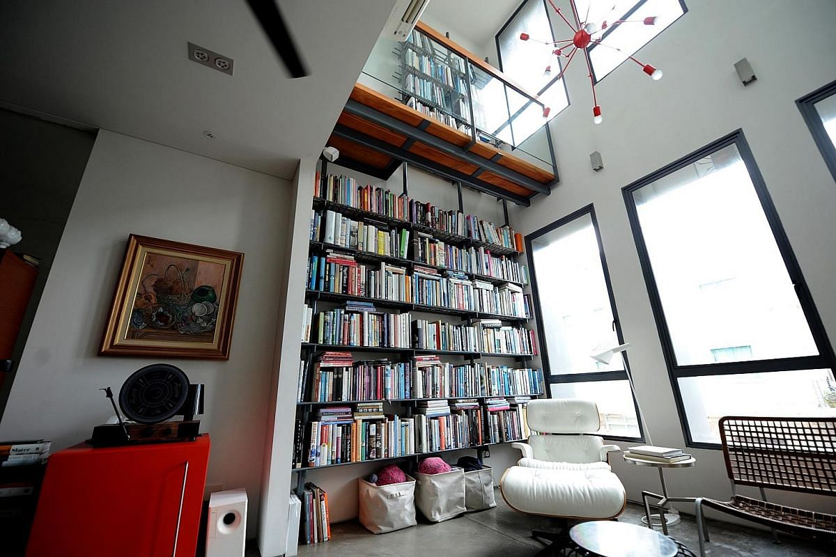 A 6m High Bookshelf Is Prominent Feature In The House Of Food Blogger Aun