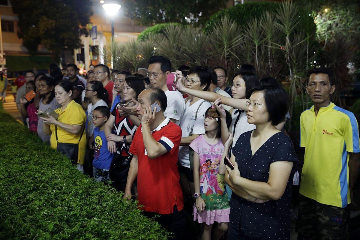 Bukit Batok residents waiting outside the PAP branch office at Blk 148 Bukit Batok West Ave 6.