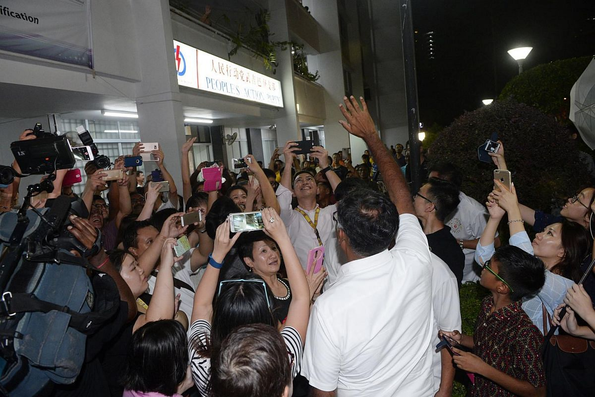 Bukit Batok's by-election winner Murali Pillai waving to residents and supporters outside the PAP branch office after being declared winner of the by-election.