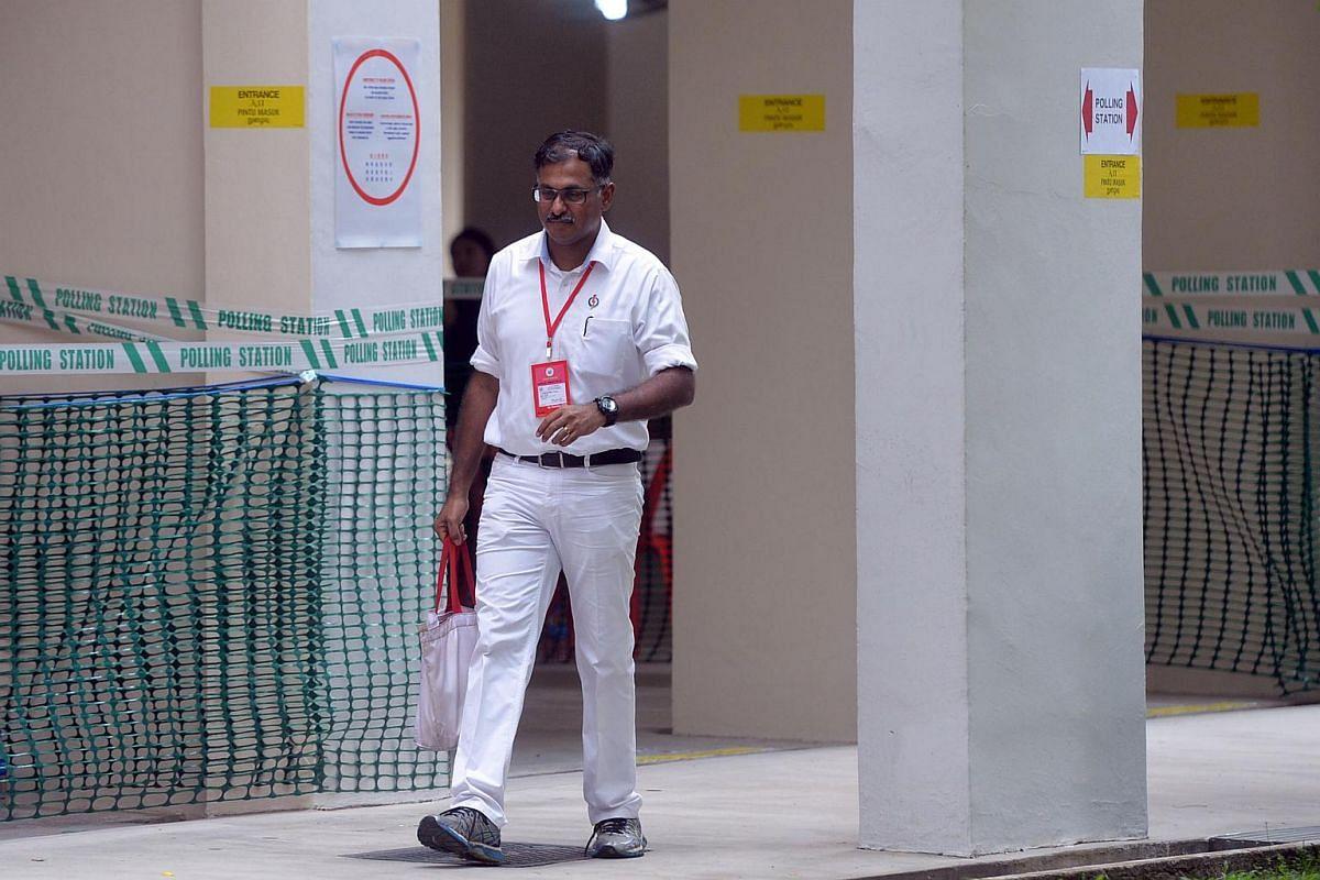 PAP's Bukit Batok candidate Mr Murali Pillai walking out of the polling station at Blk 191 in Bukit Batok.