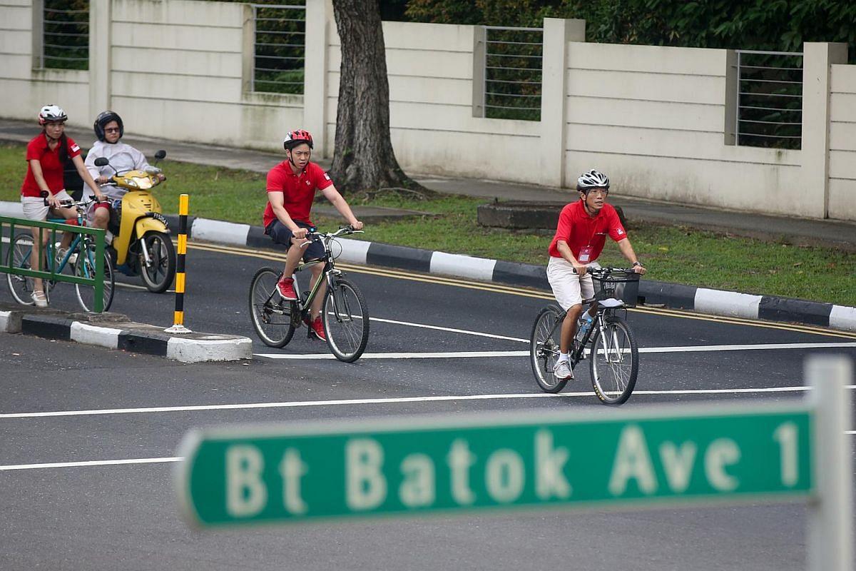 Dr Chee Soon Juan cycling between polling stations at Bukit Batok Central.