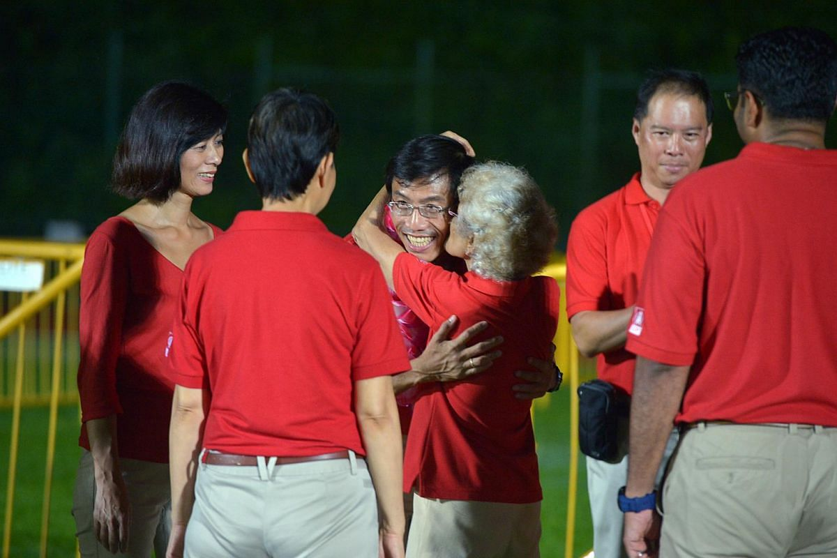 Chee Soon Juan being hugged by a supporter at Bukit Gombak stadium.