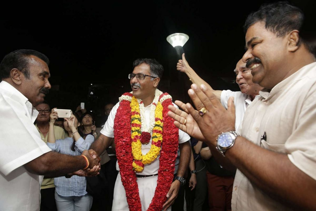 The PAP's Murali Pillai celebrating with supporters after being named the winner of the by-election.