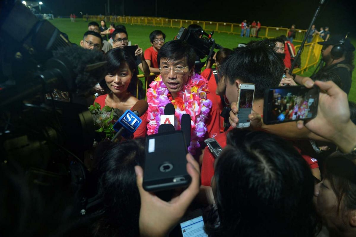 SDP chief Chee Soon Juan speaking to the media at Bukit Gombak Stadium after his loss in the by-election.