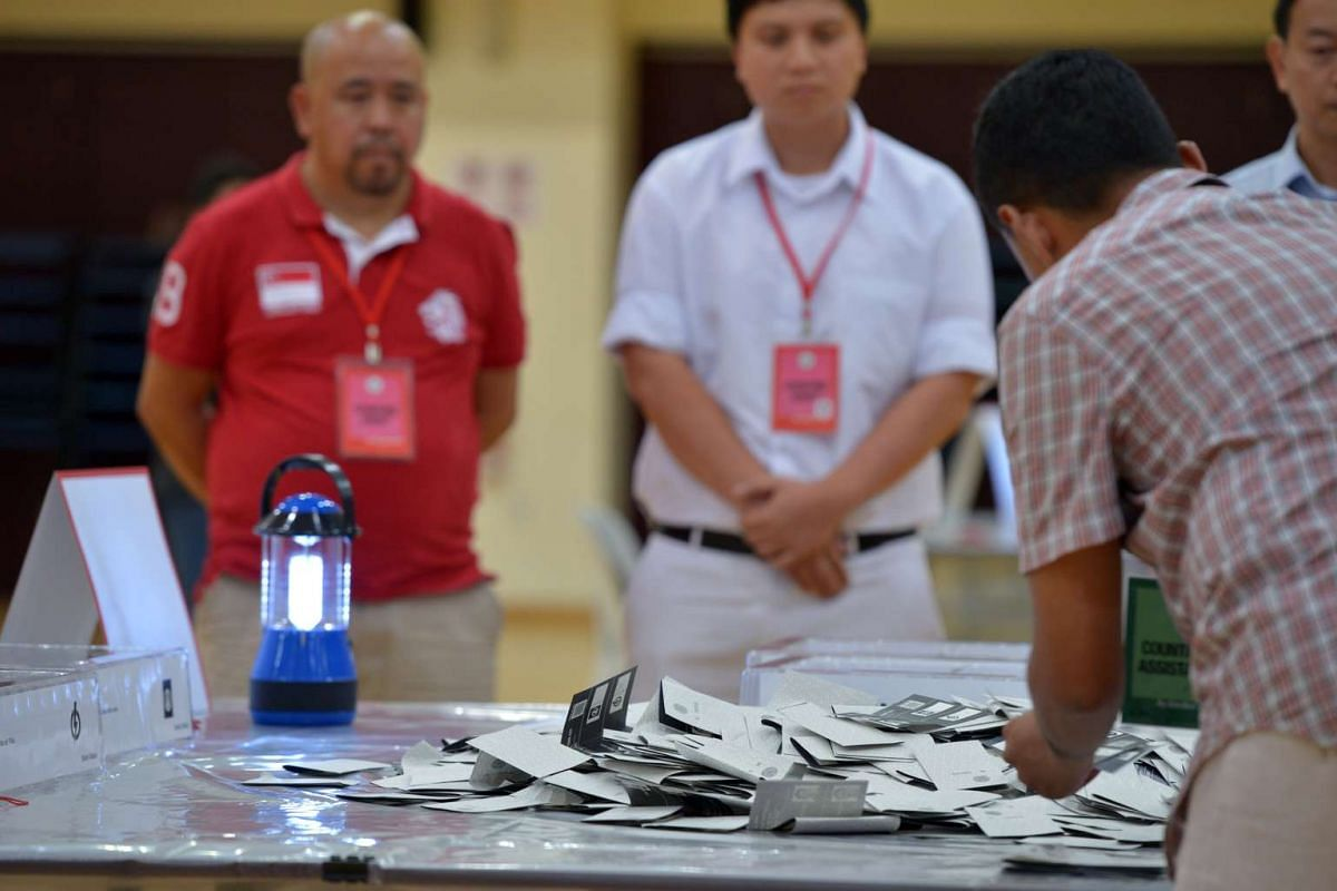 Counting begins after the arrival of the first ballot boxes at the Bukit Batok Secondary School counting centre.