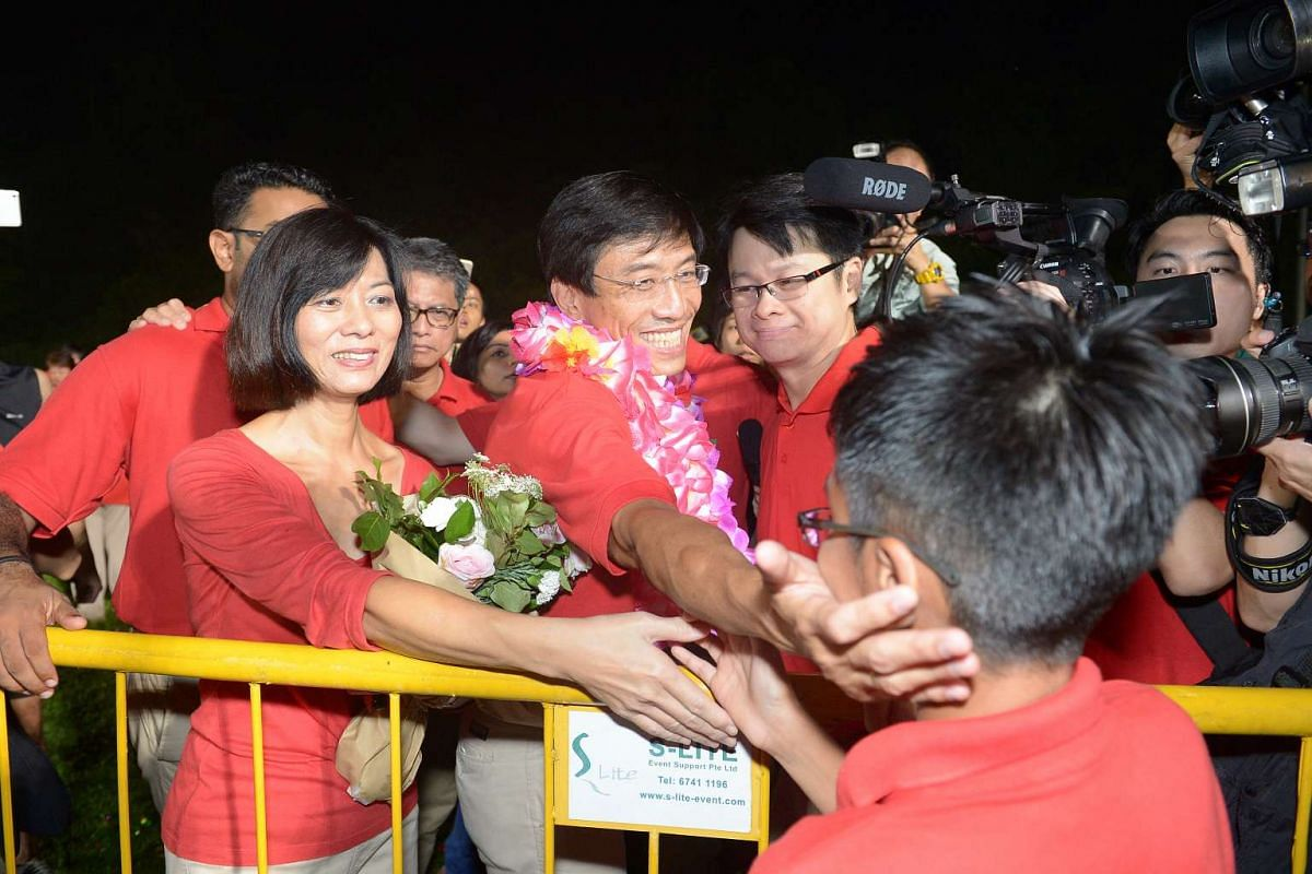 SDP chief Chee Soon Juan and his wife with supporters after the by-election results were announced.